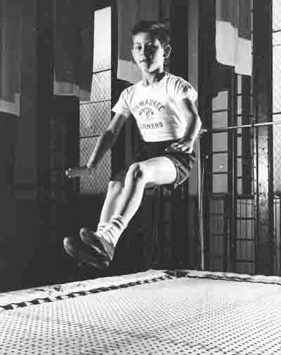 Milwaukee Turner boy bouncing on trampolilne
