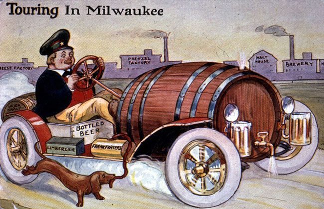 """""""Touring Wisconsin"""" postcard, showing a Dutchman driving a """"beer vehicle,"""" with a tap barrel engine, beer stein lights, and boxes for limberger and frankfurters"""